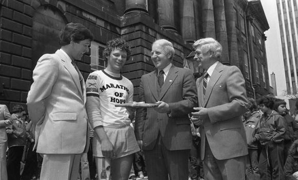 """Terry Fox's Marathon of Hope brought him to Halifax in May 1980, where he met with civic officials and ministers of the Nova Scotia government. At Province House, he was greeted by Transportation Minister Tom McInnis, Premier John Buchanan and Health Minister Dr. Gerald Sheehy"" (Chronicle Herald Archives)"