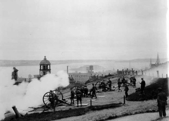 Firing the noon guns, Citadel, 1926