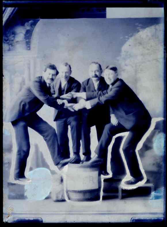 Waldren, Crook, Lassen & Sutherland photographed standing on a cider barrel in Halifax, Nova Scotia ca 1870s